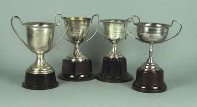 Four trophies, awarded to Tom Procter c1947-48