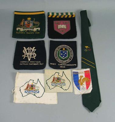 Blazer Pockets, cloth badges and a tie used by swimmer John Marshall 1947-1956.