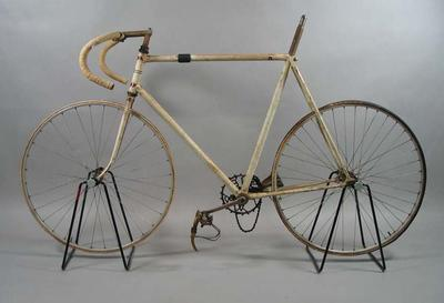 Track bicycle, white, fixed wheel, incomplete; used by Bob Pearson in the 1940's.