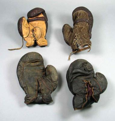 Six boxing gloves from the Harry Johns Boxing Troupe.