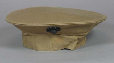 US First Marines dress uniform hat peak cover, associated with the military occupation of the MCG