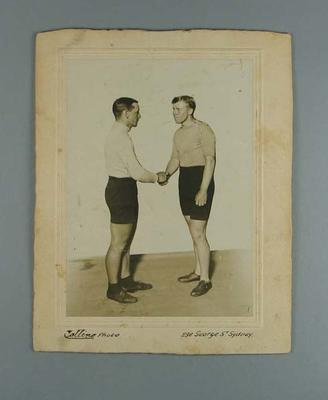 Black and white photograph of Paddy Hehir and Alf Goullet shaking hands