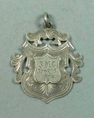 S.M.C Sports 2 Mile medal awarded to G Cook, 1908