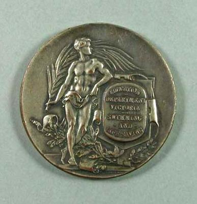 Education Department Victoria Swimming and Lifesaving medal won by N McGibbony, 1922