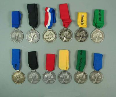 Twelve medals, Olympic Dream Runs 1990-2000; Civic mementoes; 2001.3814.67