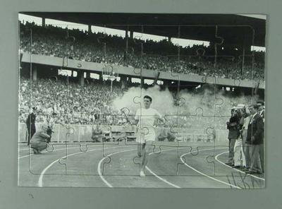 Puzzle, image of Ron Clarke with torch at 1956 Olympic Games Opening Ceremony