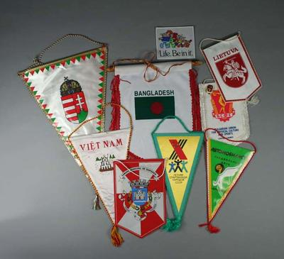 Collection of sporting pennants, cloth patches and badges