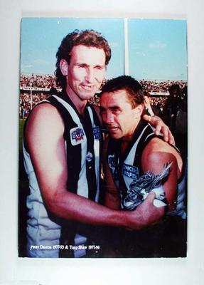 1990 AFL Grand Final, colour image mounted on board featuring Peter Daicos and Tony Shaw, Collingwood Football Club
