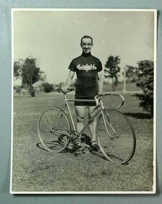 Black and white photograph of Victorian cyclist, Eric Gibaud, with  his Malvern Star equipment