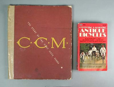 Two paperback cycling books, 'Collecting & Restoring Antique Bicycles' and 'CCM The Story of the First Fifty Years'; part of the R L Bates Collection.