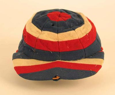 An English local cricket team cap, striped,  made by Foster in London, circa late 20th century.
