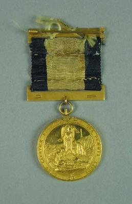Gold medallion awarded to Frank Beaurepaire, for rescuing a shark attack victim at Coogee Beach in 1922