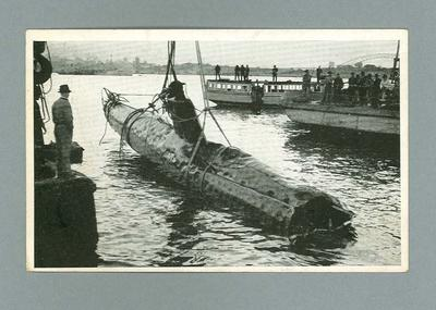 Postcard, image of Japanese midget submarine being lifted from water c1942