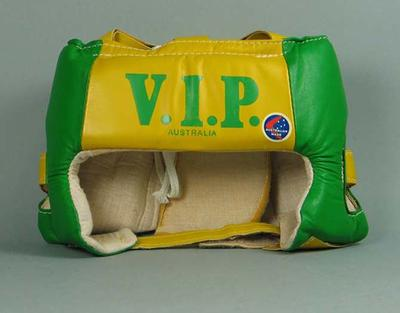 Green and gold padded boxing head guard, V.I.P. Sports brand