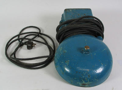 Electric bell, painted blue on the front.