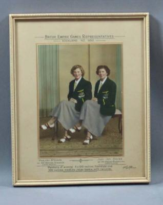 Framed colour portrait photograph - Marjory McQuade and Judy Davies - British Empire Games Representatives, Auckland New Zealand 1950