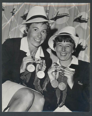 Black and white photograph, 1962 Perth Commonwealth Games - Australian athletes Judy Pollock and Pam Kilborn with their medals