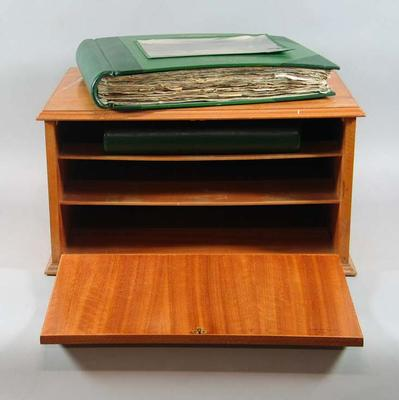 Five scrapbooks related to 1956 Olympic Games, in two purpose-built cabinets