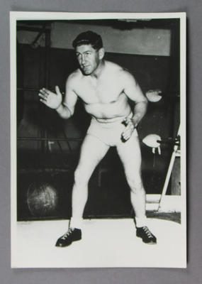 Photograph of a wrestler in a wrestling ring, c1930s