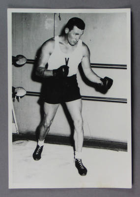 Photograph of a boxer dressed in boxing attire, c1930s