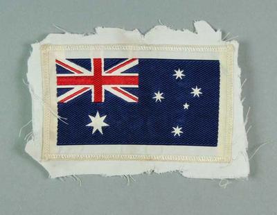 White cloth badge with Australian flag