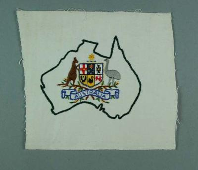 Piece of white cloth with embroidered map of Australia, cut from 1956 Olympic Games uniform tracksuit