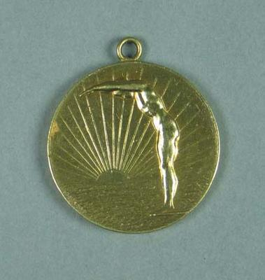 Gold medal presented for first place in 1908 UNO swimming competition, won by Frank Beaurepaire
