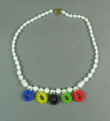 Plastic bead necklace with coloured Olympic Games rings, c1956