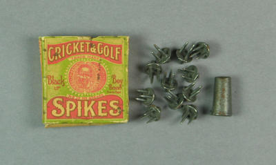 Box containing cricket and golf spikes, with driver