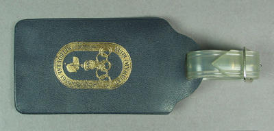 1956 Olympic Games Souvenir Luggage Tag, Navy Blue Plastic with cream card insert