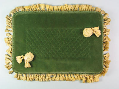 Green velvet cushion used for 1956 Olympic Games medal presentations