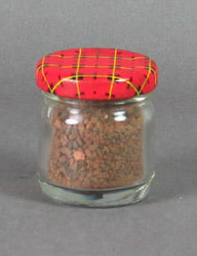 Glass jar, contains sample of 1956 Olympic Games MCG running track