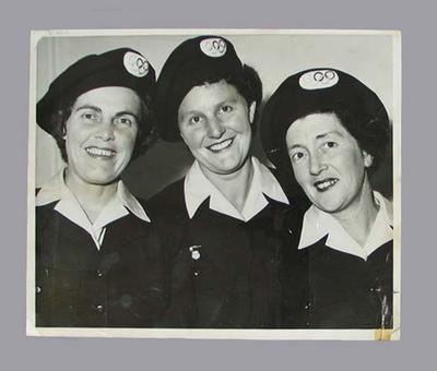Photograph of three 1956 Olympic Games volunteer lady drivers in uniform