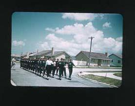 Colour slide taken during the 1956 Olympic Games, depicting a group of female athletes, marching in formation