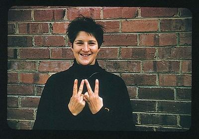 Colour slide of Dawn Fraser, holding both hands in victory sign; Photography; 1986.1047.36