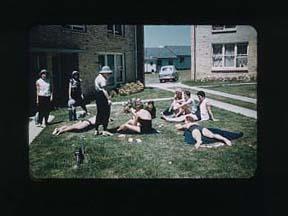 Colour slide of ten women, inside 1956 Olympic Village