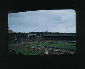 Colour slide: 1956 Melbourne Olympic Games, Closing Ceremony with Government House in Background, MCG