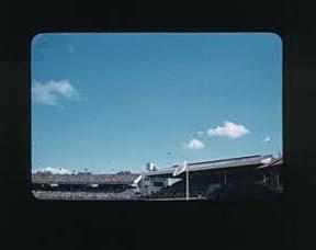 Colour slide: 1956 Melbourne Olympic Games, Olympic Flag, Northern Stand