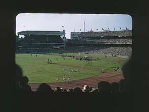 Colour slide: 1956 Melbourne Olympic Games, Vladimir Kuts USSR and Gordon Pirie, G.B. - 10,000 Metres