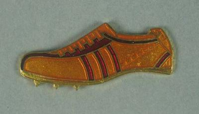 Lapel pin, depicts a running spike