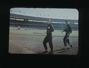 Slide, depicts an athletes at the MCG during 1956 Olympic Games