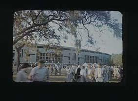 Slide, depicts exterior of MCG Northern Stand during 1956 Olympic Games