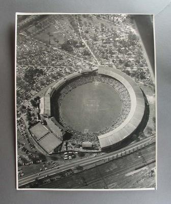 Aerial photograph of Melbourne Cricket Ground with large crowd in stands, c1956
