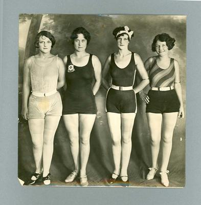 Photograph of four women in swimming costumes, c1927
