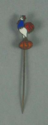 Stick pin, rooster with oval ball