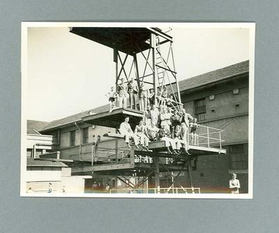 Photograph of a group of men and boys on diving tower, c1930s
