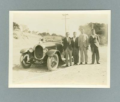 Photograph, depicts a group of young men outdoors with a car c1930s