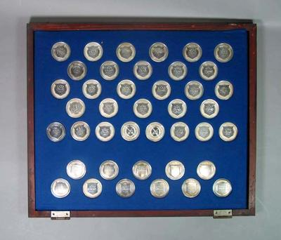 Forty-one silver Victorian Rowing medals in glass topped display case, awarded to Charles Donald and Alex Chomley