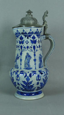 Ceramic jug with metal lid bearing blue and white cricketers design