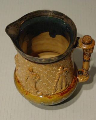 Doulton Lambeth jug with silver rim 1880